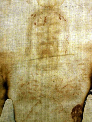 The Holy Shroud, the 14 foot-long linen revered by some as the burial cloth of Jesus, is shown at the Cathedral of Turin, Italy Saturday, August 12, 2000. The Shroud was re-inaugurated after a fire in 1997 almost destroyed it.