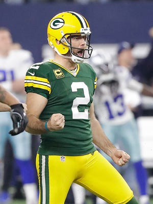 Green Bay Packers kicker Mason Crosby (2) celebrates his long field goal to take the lead late in the fourth quarter against the Dallas Cowboys at AT&T Stadium in Arlington, TX Sunday, January 15, 2017.