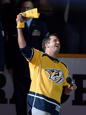 Country music star Luke Bryan gets the crowd going after singing the National Anthem before game four in the first-round NHL playoff series at the Bridgestone Arena, Thursday, April 20, 2017, in Nashville, Tenn.