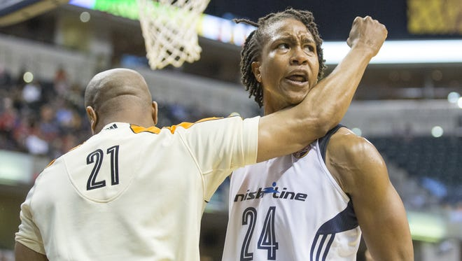 Tamika Catchings of the Indiana Fever bumps into a referee who is making a foul call during second-half action of the Fever's 77-74 victory over the Phoenix Mercury at Bankers Life Fieldhouse in Indianapolis on Friday, June 12, 2015. The WNBA suspended Catchings for a game as a result of this contact.