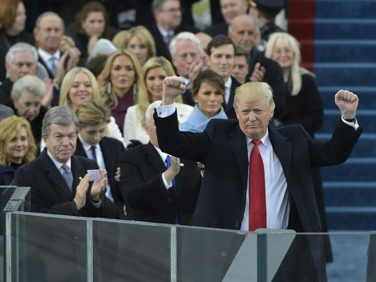 President Donald Trump acknowledging the crowd during