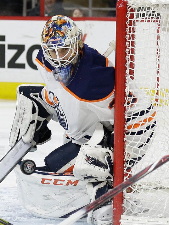 Edmonton Oilers' goalie Cam Talbot (33) defends the net during the second period of an NHL hockey game against the Carolina Hurricanes in Raleigh, N.C., Tuesday, March 20, 2018. (AP Photo/Gerry Broome)
