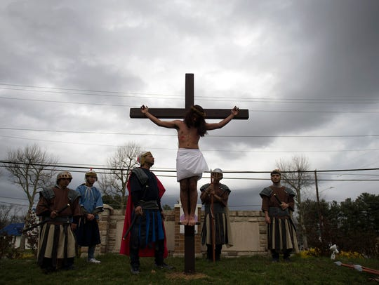 Jeremiah Rivas, 17, plays Jesus as he is nailed to