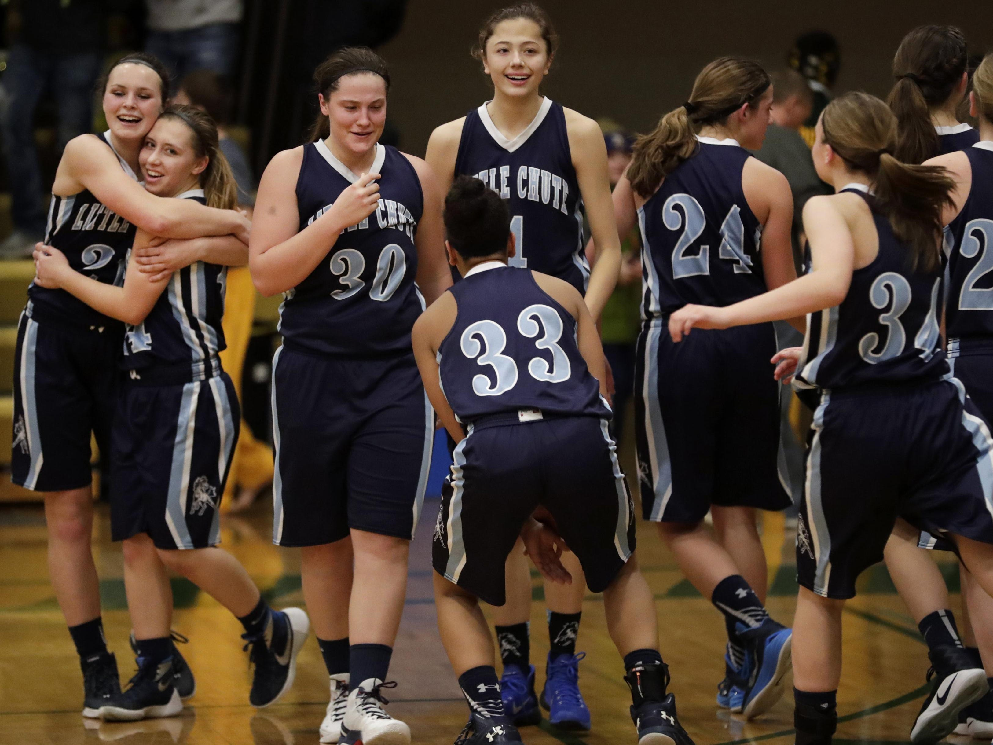 Little Chute players celebrate after their 47-44 victory Thursday over Freedom in a North Eastern Conference girls' basketball game in Freedom. See more photos from the game at postcrescent.com.