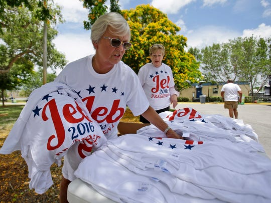 Judy Wieringa, left, and Anna Jacobson sell T-shirts outside Miami Dade College's Theodore Gibson Health Center in Miami on June 15, 2015, before Jeb Bush's 2016 announcement speech.