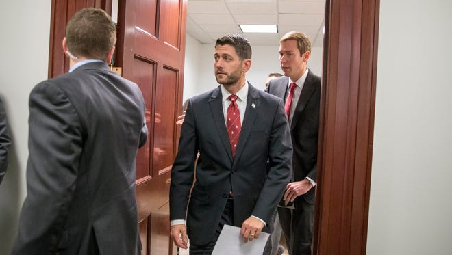 In this Dec. 1 file photo, House Speaker Paul Ryan emerges from a closed-door GOP strategy session at the Capitol in Washington.