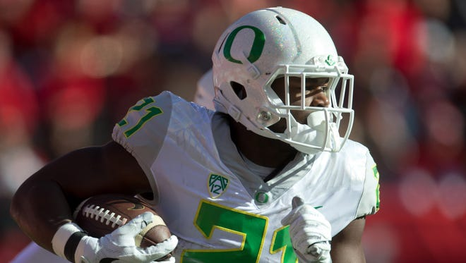 Nov 19, 2016; Salt Lake City, UT, USA; Oregon Ducks running back Royce Freeman (21) runs with the ball during the first quarter against the Utah Utes at Rice-Eccles Stadium. Mandatory Credit: Russ Isabella-USA TODAY Sports