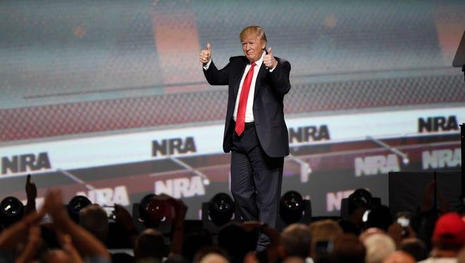 President Trump speaks at the National Rifle Association-ILA Leadership Forum on Friday in Atlanta.