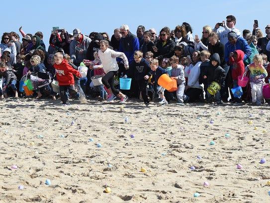 Dewey Beach's Annual Easter Egg Scoop on the beach