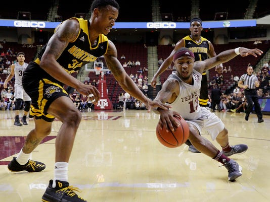 Texas A&M guard Duane Wilson (13) dives for a loose ball as Northern Kentucky guard Lavone Holland II (30) reaches in during the first half of an NCAA college basketball game Tuesday, Dec. 19, 2017, in College Station, Texas. (AP Photo/Michael Wyke)