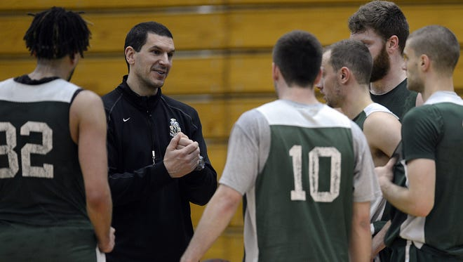 St. Norbert College men's basketball coach Gary Grzesk talks to his team during a practice session. The Midwest Conference announced Thursday that the winter sports season will be canceled.