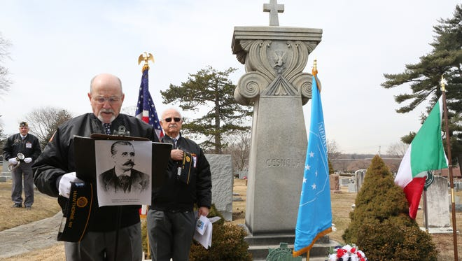 American Legion Post 112 Vice Commander Frank Morganthaler says the invocation in front of the grave of Medal of Honor-recipient Gen. Luigi P. Di Cesnola at the Kensico/Sharon Gardens cemetery Wednesday to mark National Medal of Honor Day. To his side is post Commander Pasqualino Di Sisto.