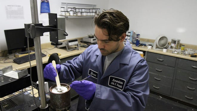 Steve Ottaviano of Eatontown, product development manager, tests thermal interface material on a thermal conductivity tester at American Oil & Supply in Eatontown.