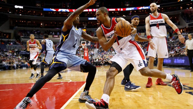 Washington Wizards guard Ramon Sessions (7) drives against Memphis Grizzlies guard Russ Smith (2) during the second half of an NBA basketball game Thursday, March 12, 2015, in Washington. The Wizards won 107-87.