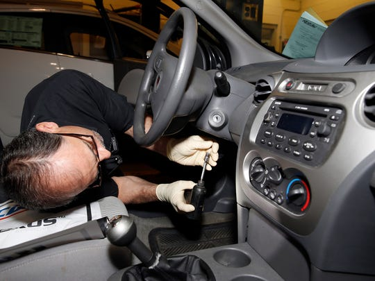 Shop foreman John Chapman performs a service recall on a General Motors Co. (GM) 2005 Saturn Ion at Liberty Chevrolet in New Hudson, Michigan, U.S., on Friday, April 25, 2014. General Motors is installing thousands of kits consisting of ignition switches, ignition cylinders and key sets for older model small cars subject to a safety recall. Photographer: Jeff Kowalsky/Bloomberg
