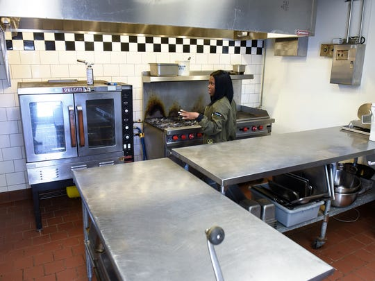 Diyon Lee stands in the commercial kitchen Thursday,