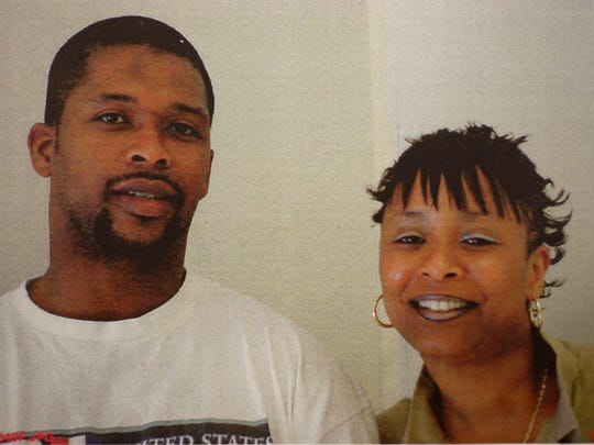 This is a copy of a photo of Paula Cooper, right, and Michael Johnson in 2004.