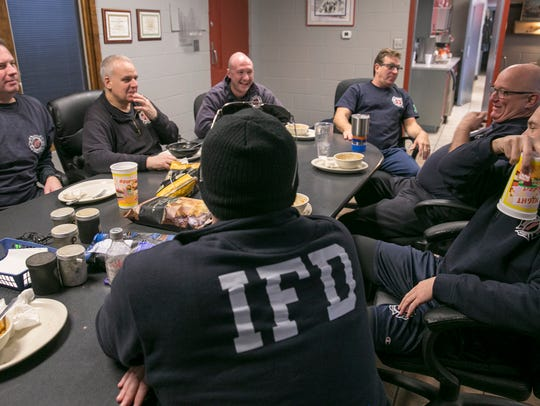 Members of Engine and Ladder 27 have lunch at the firehouse,