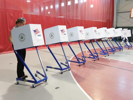 A resident votes in an East Ramapo school election