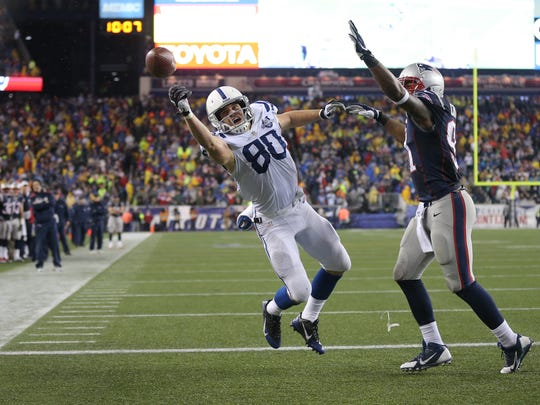 The ball is just out of the reach of Indianapolis Colts Coby Fleener against New England Patriots Jamie Collins during the third quarter at the AFC playoff game Saturday, January 11, 2014, evening at Gillette Stadium in Foxborough,MA.