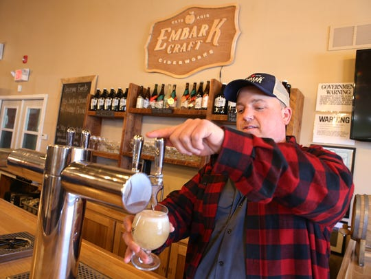 Jacob Lagoner pours a glass of American Hopped Cider