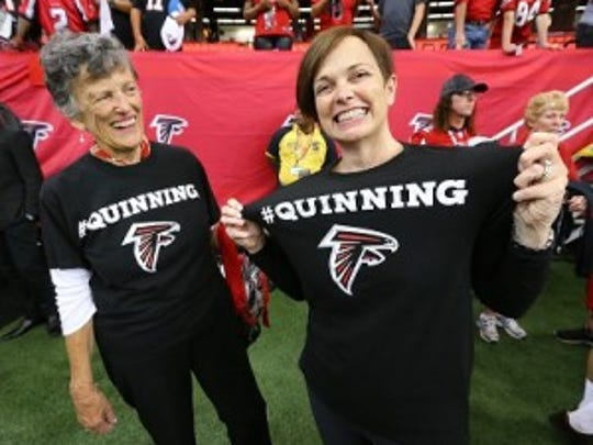 Sue Quinn, the mother of Falcons head coach Dan Quinn, and his sister Maribeth Eppen, are on the sidelines to support him in his first NFL football game as a head coach last Monday. (Curtis Compton/Atlanta Journal-Constitution via AP)