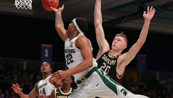Michigan State Spartans guard Miles Bridges (22) shoots as Wichita State Shockers center Rauno Nurger (20) defends during the second half in the 2016 Battle 4 Atlantis in the Imperial Arena at the Atlantis Resort.