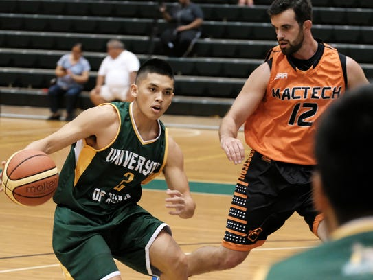 UOG guard Aaron Castro looks for an opening as MacTech's