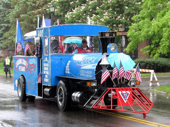 A float sponsored by Chemung County veterans takes part in  Monday's Elmira Memorial Day parade.