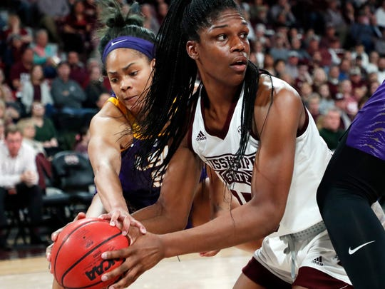 Mississippi State center Teaira McCowan (15) looks for a teammate while LSU forward Ayana Mitchell (5) reaches in to attempt a steal during the first half of an NCAA college basketball game in Starkville, Miss., Thursday, Feb. 28, 2019. (AP Photo/Rogelio V. Solis)