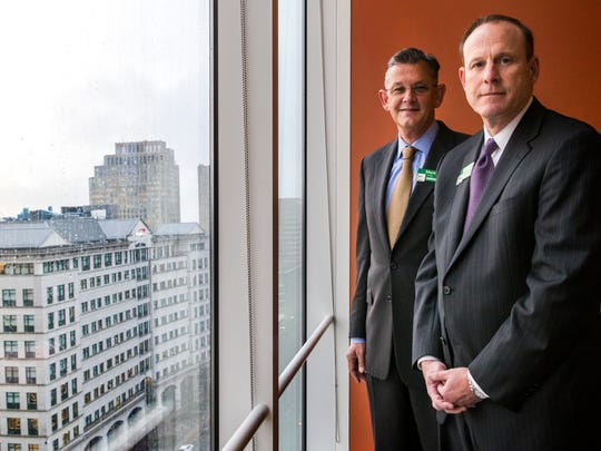 WSFS Executives Mark Turner, left, and Rodger Levinson, right, pose for a portrait at the company's Downtown Wilmington office in December.