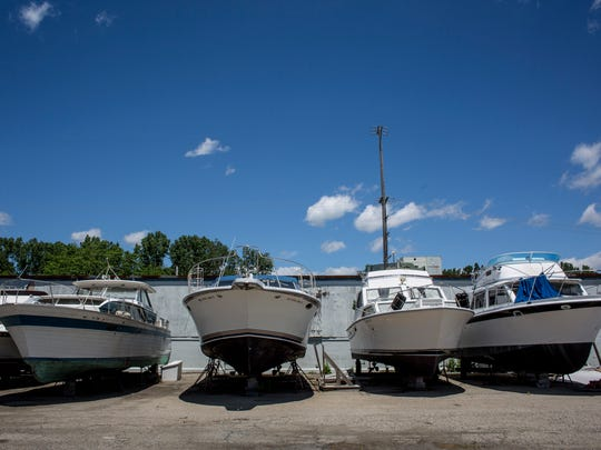 A line of abandoned boats pictured Wednesday, June 8, 2016 at Algonac Harbour Club.  House Bill 5429, which was approved by the House June 1, would amend the Marina and Boatyard Storage Lien Act to help streamline the process of selling or disposing of abandoned boats.