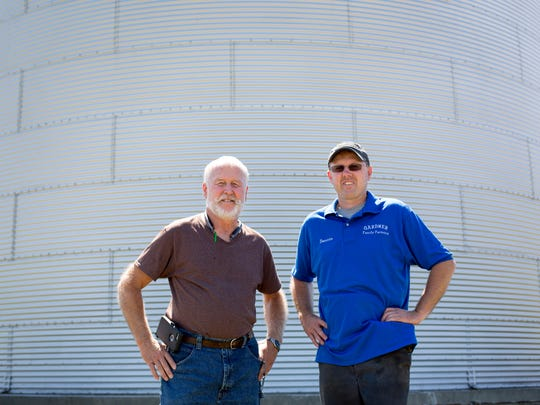 Bruce Gardner poses with his son Dennis Gardner at their farm on Galbraith Line Road in Fremont Township. The Gardners farm about 550 acres of soybeans.
