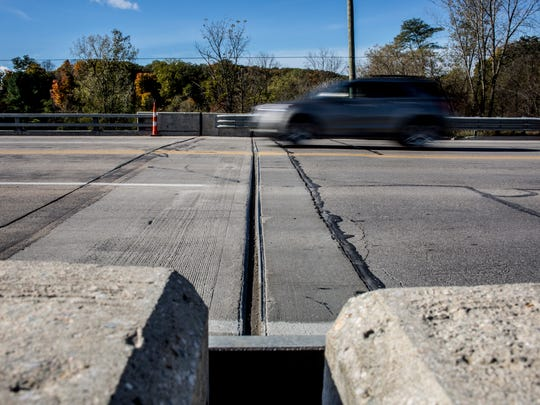 Vehicles travel on the Wadhams Road Bridge over the Black River Friday, Oct. 28, 2016 in Kimball Township. Repair work will be done on the roadway approaching the bridge on Monday.