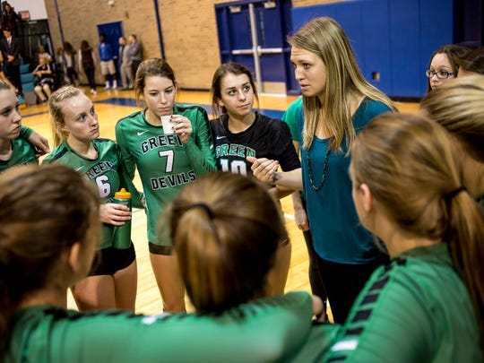 Coach Jenna Welke talks with players in a huddle during a Class C regional volleyball game Thursday, Nov. 10, 2016 at Flint Hamady High School.