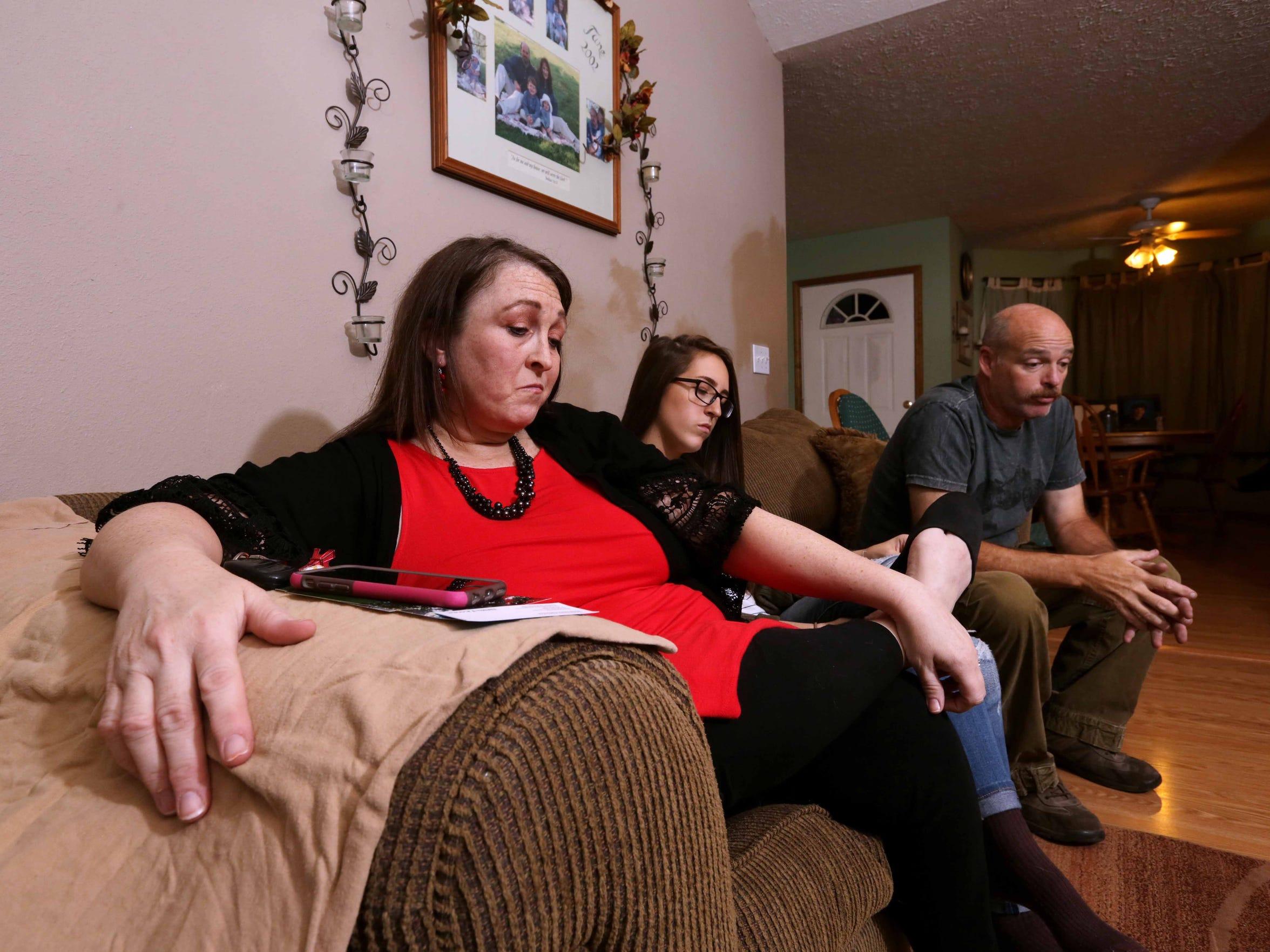 Brett and Heidi Clark, and their daughter Jadyn, still