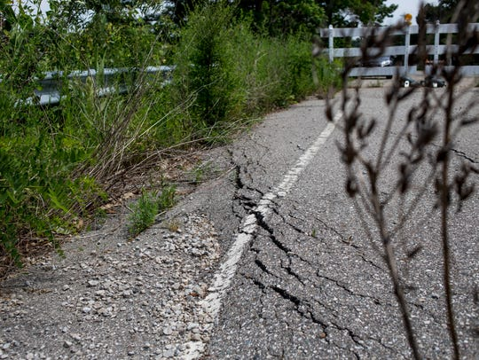 St. Clair Highway is seen sinking where it remains