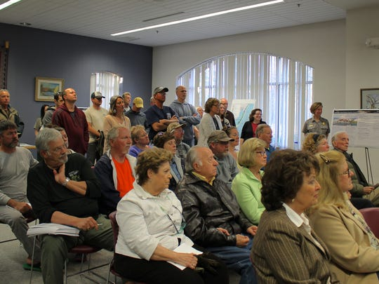 The audience at the Ocean Pines Library listens to the NPS presentation.