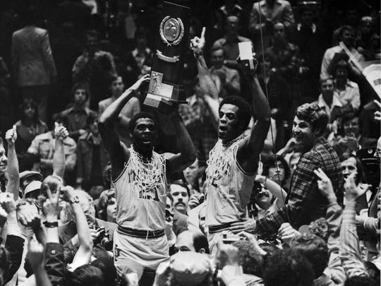 (L to R) Quinn Buckner, Scott May, Bobby Knight celebrate the Indiana University win over Michigan in the 1976 NCAA Tournament at the Spectrum in Philadelphia.