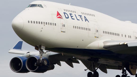 A Delta Air Lines Boeing 747-400 jet is seen in flight