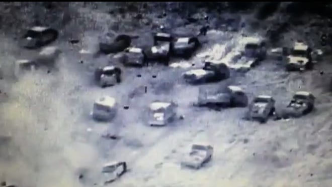 This image made from video released by Iraq's Counterterrorism Service shows an Islamic State militant convoy destroyed by airstrikes near Fallujah, Iraq on June 29, 2016.