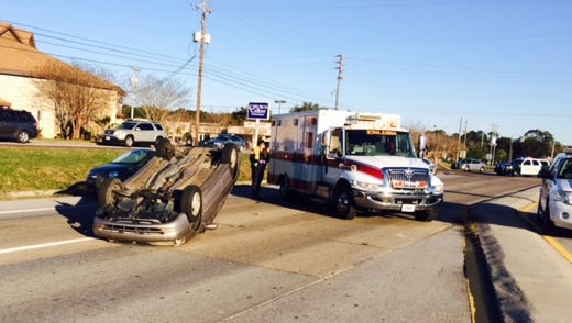 A car is overturned on Navy Boulevard near Patton Road Thursday morning.
