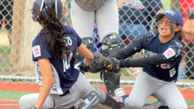 Silver City All Star Lisa Lucero covered home plate on a pass ball while Deming All Star Jenae Jasso slides in safe during Tuesday's Major Division (11-12) District 7 Little League softball action at Hooten Park.