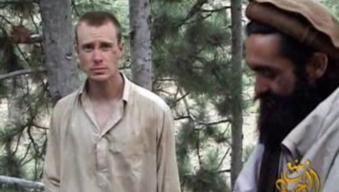 This image provided by IntelCenter on Dec. 7, 2010, shows the Taliban associated video production group Manba al-Jihad release of someone that appears to be Sgt. Bowe Bergdahl, who was held hostage for five years after being captured by the Taliban in Afghanistan.