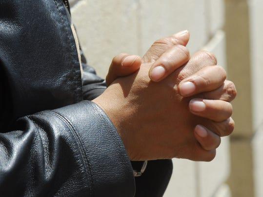 hands folded in prayer.jpg