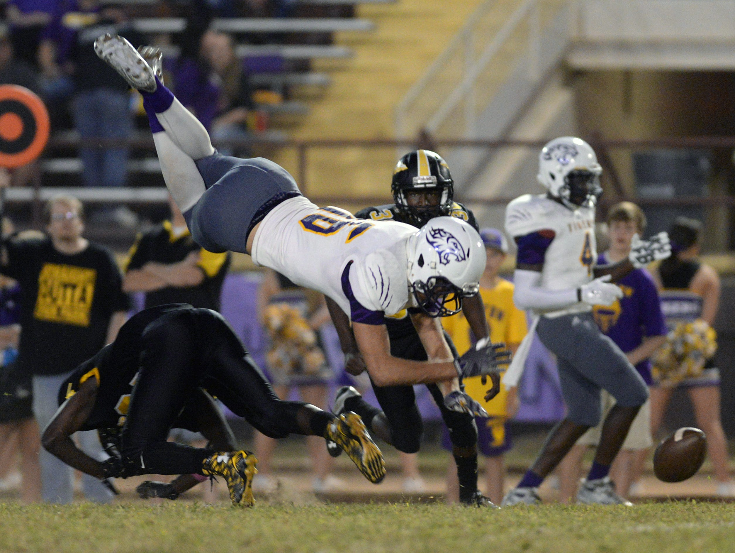Fair Park's Latrevione Davis up ends John Westmoreland of Benton, breaking up a pass attempt in the first quarter of their game.
