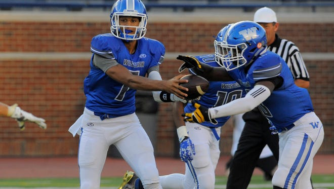Walled Lake Western's Cody White, left and Jesse Williams tackle Canton in Week 2.