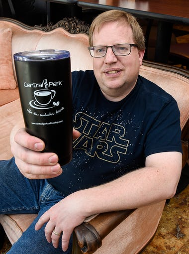 Alan Scherr, owner of Central Perk Coffee Shop, is under pressure to change its name due to a trademark held by the Warner Bros. Entertainment Inc. Scherr is shown on April 25, 2018, in St. Cloud.
