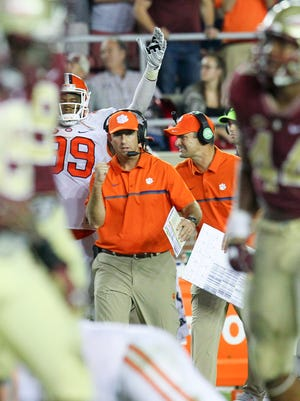 Clemson head coach Dabo Swinney pumps his fist after kicker Greg Huegel(92) kicked a go-ahead field goal during the fourth quarter on Saturday October 29 at Doak Campbell Stadium in Tallahassee, Florida.