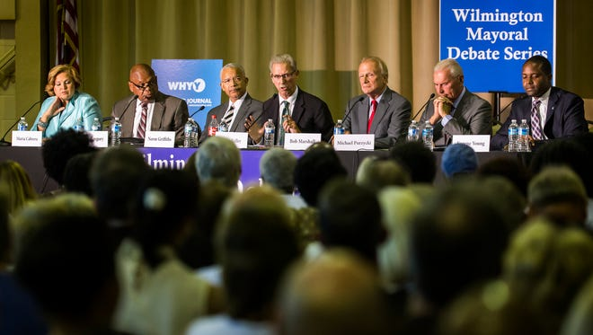 Wilmington mayoral candidates fill a table in front of a crowd of hundreds during the Wilmington mayoral debate at the Holy Trinity Greek Orthodox Church in Wilmington on Tuesday night.